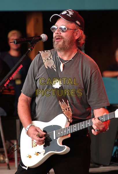 HANK WILLIAMS JR.Performs at Jamboree In The Hills.Morristown, 16th July 2005.country music singing microphone grey t-shirt sunglasses    .baseball hat half length half-length juitar.www.capitalpictures.com.sales@capitalpictures.com.© Capital Pictures.
