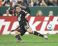 Santino Quaranta #25 of D.C. United sends over a cross during an MLS match against the New England Revolution on April 3 2010, at RFK Stadium in Washington D.C.