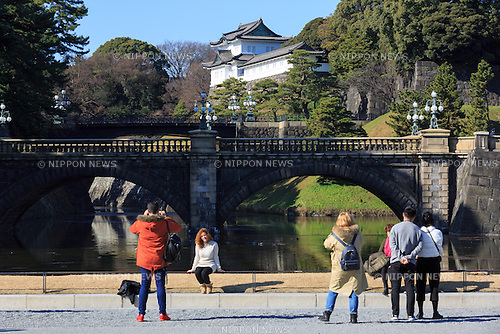 Visitors take pictures of the Seimon-Tetsubashi (Main Gate Bridge) of Tokyo Imperial Palace, on January 12, 2017, Tokyo, Japan. The Japanese government is discussing legal changes to allow for the abdication of Emperor Akihito (83 year old) and the ascension to the throne of his eldest son Crown Prince Naruhito on New Year's Day 2019. This would be the 30th year of the Akihito's reign. Current Japanese law has no provision to allow an Emperor to step down, but there is public support for Akihito to step aside after a public address in 2016 where he expressed concern that his age may stop him from carrying out his Imperial duties. The government is also discussing setting a new era name in the Japanese calendar to correspond to the new emperor's reign and by starting on January 1st 2019 they hope to avoid confusion to people's lives. (Photo by Rodrigo Reyes Marin/AFLO)