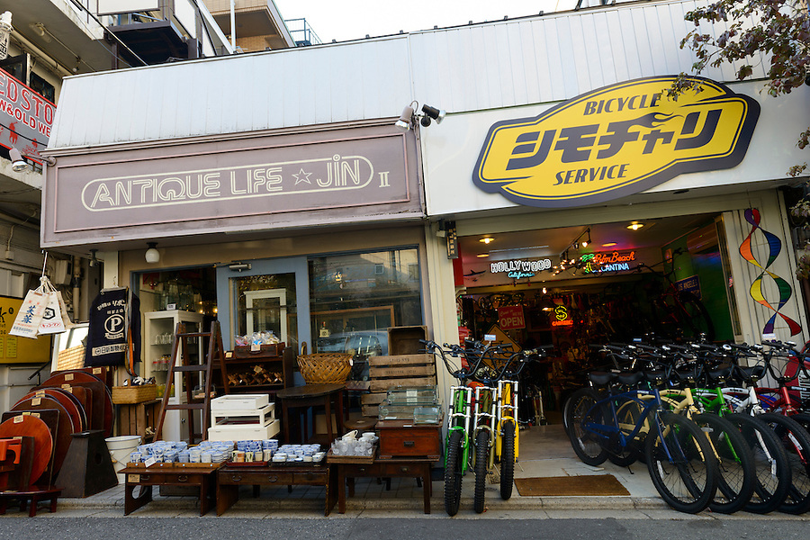 Antique/vintage goods shop and bike shop, Shimokitazawa, Tokyo, Japan, November 1, 2012. Shimokitazawa is a fashionable area popular with students and packed with cool bars, restaurants, shops and music venues.
