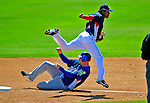 3 March 2009: Washington Nationals' second baseman Anderson Hernandez leaps over a sliding Valentino Pascucci in a double play against Italy during a Spring Training exhibition game at Space Coast Stadium in Viera, Florida. The Nationals defeated Italy 9-6. Mandatory Photo Credit: Ed Wolfstein Photo