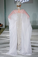 Model walks the runway in a Beth Elis Noor wedding dress by Nere Emiko during the Wedding Trendspot Spring 2011 Press Fashion, October 17, 2010.