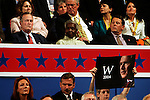 New York, NY, USA, 20040831: The Republican National Convention in New York. Former US President George H. W. Bush listens to First Lady Laura Bush as a RNC supporter holds up a sign of  George W. Bush.....Photo: Orjan F. Ellingvag/ Dagbladet Sygma *** Local Caption *** edited, moved to edited 20060218moved to edited 20060710,