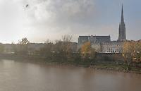 The river Garonne and the spire of the Basilique Saint Michel, or St Michael's Basilica, a Flamboyant Gothic church built 14th - 16th centuries, Bordeaux, Aquitaine, France. Picture by Manuel Cohen