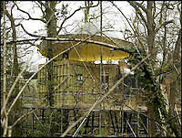 BNPS.co.uk (01202 558833)<br /> Pic: Mallinson/BNPS<br /> <br /> Taking shape in the wood...<br /> <br /> Release your inner Tarzan...in Britain's poshest treehouse.<br /> <br /> A luxury glamping site in deepest Dorset has created a luxurious treehouse that comes with its own sauna, hot tub, rotating fireplace and pizza oven.<br /> <br /> The Woodsman's Treehouse is perched 30ft from the ground on long stilts and has two floors. <br /> <br /> It has a spiral staircase and a stainless steel slide for quick access to the ground and can be rented out from &pound;390 a night. <br /> <br /> It is located at the Crafty Camping glamping site at Holditch in west Dorset.