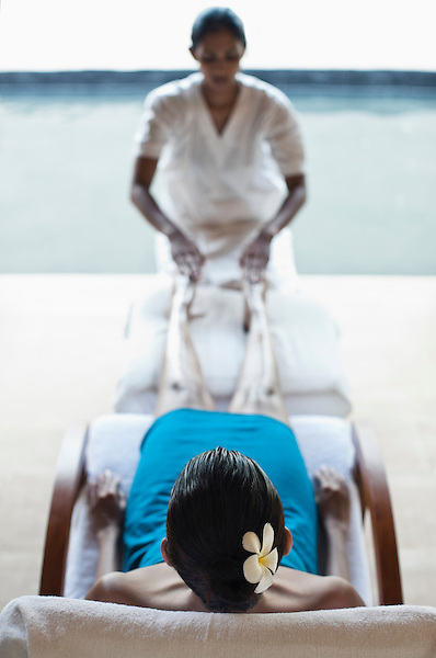 A woman receives a Thai Reflexology Treatment at the Sahana Spa, Saman Villas, Aturuwella, Bentota, Sri Lanka. This 70-minute treatment involves a therapist using long, smooth strokes to release muscle tension in the lower leg and applying gentle pressure to various points on the feet to release blockages in energy flow. Reflexologists believe that the whole body is mapped out on the feet, so releasing these blockages promotes healing in the body overall.