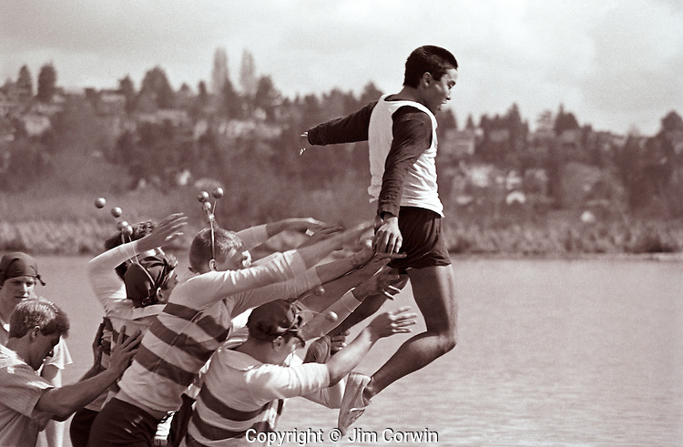 Eight man crew  back at dock throw into coxswain into water after victory Seattle Washington State USA