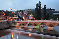 The Seher-Cehaja Bridge in the evening, a 16th century Ottoman bridge crossing the Miljacka river, Sarajevo, Bosnia and Herzegovina. The city was founded by the Ottomans in 1461. Picture by Manuel Cohen