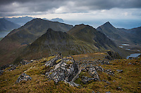 View over mountain landscape from the summit of Stornappstind (740m), Flakstadøy, Lofoten Islands, Norway