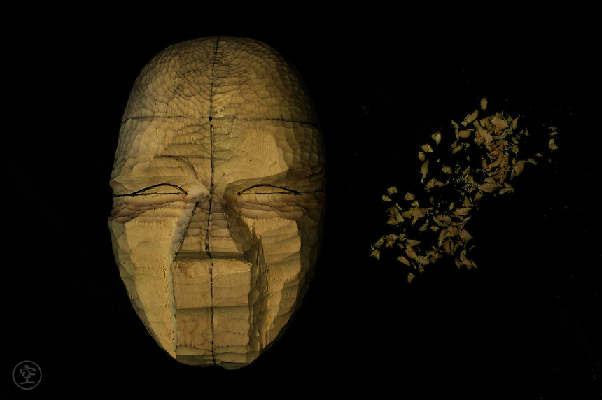 Mask in the early process of carving by Kojima Oun.