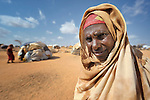 A Somali woman in the Dadaab refugee camp in northeastern Kenya. Tens of thousands of newly arrived Somalis have swelled the population of what was already the world's largest refugee camp.