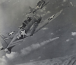 Navy SBD Dauntless A-24 Banshee dive bombers attack the Japanese fleet off Midway Island 4-6 July 1942. Smoke below comes from a burning Japanese shit, the Mikuma. Photograph pulled from original 16mm film.