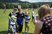 Stuart Hooper of Bath Rugby poses for a photo with supporters. Bath Rugby Family Festival of Rugby, on August 8, 2015 at the Recreation Ground in Bath, England. Photo by: Patrick Khachfe / Onside Images