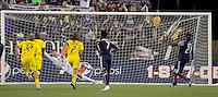 New England Revolution midfielder Shalrie Joseph (21) beats Columbus Crew goalkeeper William Hesmer (1) on a penalty kick. The New England Revolution tied Columbus Crew, 2-2, at Gillette Stadium on September 25, 2010.