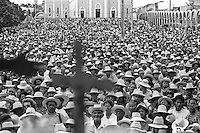 Outdoor catholic mass, people praying, religious fervour at Juazeiro do Norte city, Ceara State, Northeastern Brazil. Priest´s hand conducting the crowd.
