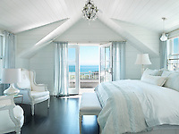 The master bedroom has its own balcony overlooking the ocean and the beach on Surfside