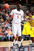 CHARLOTTESVILLE, VA- NOVEMBER 29: Assane Sene #5 of the Virginia Cavaliers reacts to a call during the game on November 29, 2011 at the John Paul Jones Arena in Charlottesville, Virginia. Virginia defeated Michigan 70-58. (Photo by Andrew Shurtleff/Getty Images) *** Local Caption *** Assane Sene
