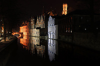 """BRUGES, BELGIUM - FEBRUARY 06 : A sidelong view of the Court of Justice buildings with the reflection in the waters of a canal by night on February 06, 2009 in Bruges, West Flanders, Belgium. The well-lit """"Beffroi"""" (Belfort) appears on the top in the background. (Photo by Manuel Cohen)"""