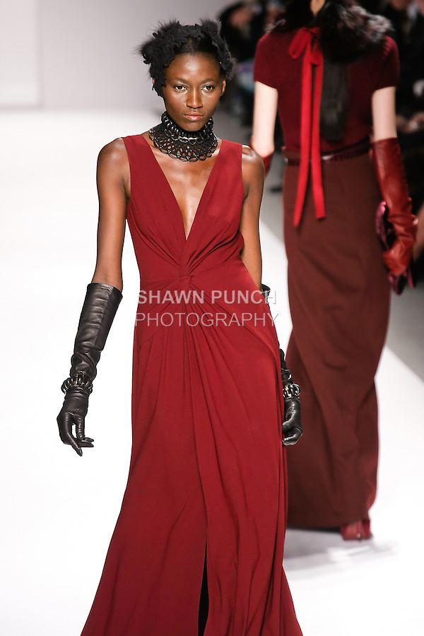 Kinée Diouf walks runway in an outfit from the Elie Tahari Fall 2011 collection, during Mercedes-Benz Fashion Week Fall 2011.