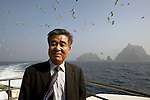 Shin Yeon-sung, secretary-general of the Northeast Asian History Foundation, stands on the ferry as it pulls away from disputed Dokdo Islands, known to Japanese as Takeshima, South Korea on on 22 June 2010..Photographer: Robert Gilhooly