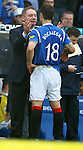 Ally McCoist greets Carlos Bocanegra with affection as the USA captain gets some instruction from his gaffer