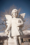 Angel statue headstone, bare tree, Paradise Valley Cemetery, Nev.