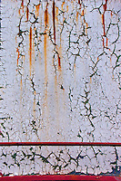 Rust, an agent of change creating abstract landscapes on steel surfaces. Photograph of the fractal beauty of rust, an agent of change. Rust is a commonly used metaphor for slow decay, since it gradually converts robust iron and steel metal into a soft crumbling powder. In the mindset of the all prevailing polarities however, in my view, this photo can be interpreted as the beginning and continuation of abstract landscapes created by corrosion on painted iron surfaces. All a matter of perspective...