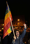 Northampton resident Gina K. Ayvazian waves a rainbow flag while pumping her fist during a rally celebrating the Massachusetts Supreme Judicial Court's ruling that same-sex couples are entitled to wed under the state constitution in Northampton on Tuesday, November 18, 2003. Photo by Christopher Evans