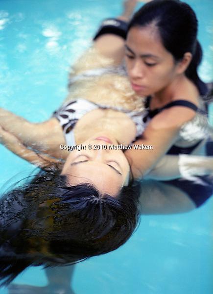 A Watsu therapist gives a water massage at Mandala Spa. Boracay Island, Philippines.