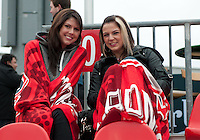 21 April 2012: Toronto FC fans keep warm during a game between the Chicago Fire and Toronto FC at BMO Field in Toronto..The Chicago Fire won 3-2....