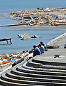 April 1st, 2011, Yamadamachi, Japan - Workers take a break from their cleaning operations in Yamadamachi, Iwate Prefecture, on April 1, 2011, three weeks after this otherwise sleepy northeastern Japanese fishing vilalge was devastated by a magnitude 9.0 earthquake and ensuing tsunami. (Natsuki Sakai/AFLO) [3615] -mis-.