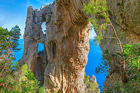 The Arch, quadriple natural arch on cliffs above Capri and Tyrrhenian Sea, Italy