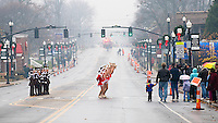 Dance teams perform in front of City Hall in Westerville, Ohio, before the annual Christmas parade arrives during a wet, rainy parade.  Photo Copyright Gary Gardiner. Not for reproduction without written permission.