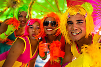 Brazilian boys, dressed as girls, perform during the carnival street party in Copacabana, Rio de Janeiro, Brazil, 18 February 2012. Most of the carnival street parties in Rio are organized and run by Blocos. Each Bloco consists of a musical band and a group of partygoers. The Blocos, closely linked to the neighborhoods they come from, start their free-to-join parades early in January and continue throughout the carnival season. Playing usually their own samba song, backed up with a numerous bateria (drum and percussion players), Blocos are considered the beating heart of the Rio Carnival.