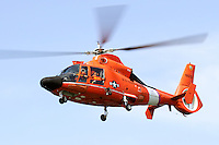 A United States Coast Guard HH-65C Dolphin helicopter in flight over San Francisco Bay.The helicopter and crew, based at U.S. Coast Guard Air Station San Francisco, was on a practice mission with the Coast Guard Auxilary to maintain search and rescue proficiency. Photographed 04/08