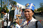 """A woman participates in a vigil outside a Phnom Penh court on December 14, 2012, during a hearing in which judges denied an appeal by Mam Sonando, a Cambodian radio journalist and human rights activist. Mam Sonando was sentenced in October 2012 to 20 years in prison for """"insurrection,"""" despite local and international calls for his release."""