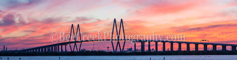 This is the Fred Hartman Bridge outside of  Houston which runs across the ship channel between Baytown and La Porte Texas. This is a very long bridge which runs about 2.6 miles.  On this day we had been in the area and decided to go see if we could capture it and boy did we get an incredible sunset. This bridge replaced the Baytown tunnel which went under the water because they need it to be deeper,  As a child we would drive through the tunnel and I was alway scare it would collapse on us. Watermark will not appear on image