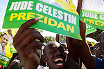 Supporters of Haitian presidential candidate Jude Celestin rally outside a polling station as he cast his ballot inside in Port-au-Prince, Haiti.