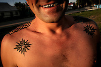 A man with gold teeth displays tattoos featuring swastikas stands barechested in the centre of Tiraspol capital of Transnistria. Also known as Trans-Dniestr or Transdniestria, Transnistria, located mostly on a strip of land between the Dniester River and the eastern Moldovan border with Ukraine, broke away from Moldova in 1990 and although a de facto independent state, governed by the Pridnestrovian Moldavian Republic (PMR), is not recognised internationally.