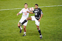 Alex Hadley (23) of the Cincinnati Bearcats and Greg Davis (14) of the Providence Friars. The Providence Friars defeated the Cincinnati Bearcats 2-1 during the semi-finals of the Big East Men's Soccer Championship at Red Bull Arena in Harrison, NJ, on November 12, 2010.