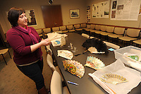 NWA Democrat-Gazette/ANDY SHUPE - Deborah Weddle of Fayetteville, a research assistant for the Arkansas Archeological Survey at the University of Arkansas, collects antique folding fans. Wednesday, Jan. 21, 2015.