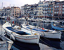 AA00369-02...FRANCE - Fishing boats in the Cannes Harbor, part of the French Riviera.