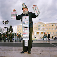 A street preacher standing in front of the Parliament building in Syntagma Square.