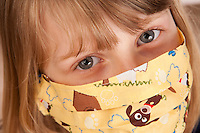 Young Girl with fun medical mask with puppy desing