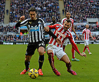 Daryl Janmaat of Newcastle United (right) fends off Phillip Bardsley of Stoke City