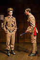 London, UK. 02.04.2014. ANOTHER COUNTRY, by Julian Mitchell, directed by Jeremy Herrin, opens at the Trafalgar Studios after a successful run at Chichester's Minerva Theatre last year. Picture shows: Rob Callender (Bennett) and Rowan Polonski (Fowler). Photograph © Jane Hobson.