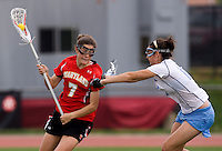 Kara Cannizzaro (15) of North Carolina defends Katie Schwarzmann (7) of Maryland during the ACC women's lacrosse tournament finals in College Park, MD.  Maryland defeated North Carolina, 10-5.