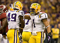 Eric Reid of LSU celebrates with Barkevious Mingo of LSU after making big play during BCS National Championship game against Alabama at Mercedes-Benz Superdome in New Orleans, Louisiana on January 9th, 2012.   Alabama defeated LSU, 21-0.