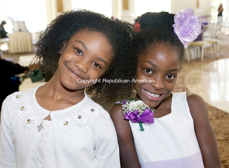 PROSPECT CT. 02 May 2015-050215SV14-Saryaha Jones, 7, and Elise Taylor, 8, both of Waterbury attend The Greater Waterbury Chapter of the National Congress of Black Women, Inc. Scholarship Luncheon at Aria Wedding and Banquet Facility in Prospect Saturday. <br /> Steven Valenti Republican-American