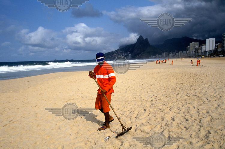 A beach cleaner in Rio.